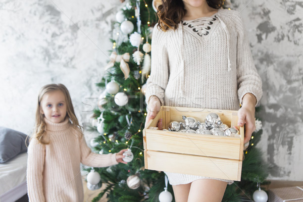 Woman holds a box with a lot of Christmas silver decorations nea Stock photo © dashapetrenko
