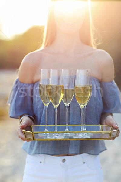 Szczęśliwy kobieta taca szampana Zdjęcia stock © dashapetrenko