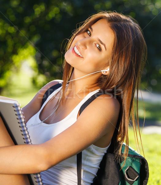 Happy young student outdoors  Stock photo © dashapetrenko