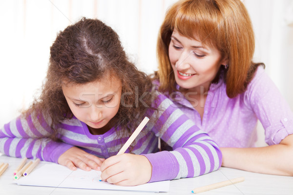 Little girl with and her mother drawing Stock photo © dashapetrenko