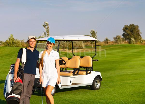 Genç çift oynama golf golf sahası ayakta Stok fotoğraf © dashapetrenko