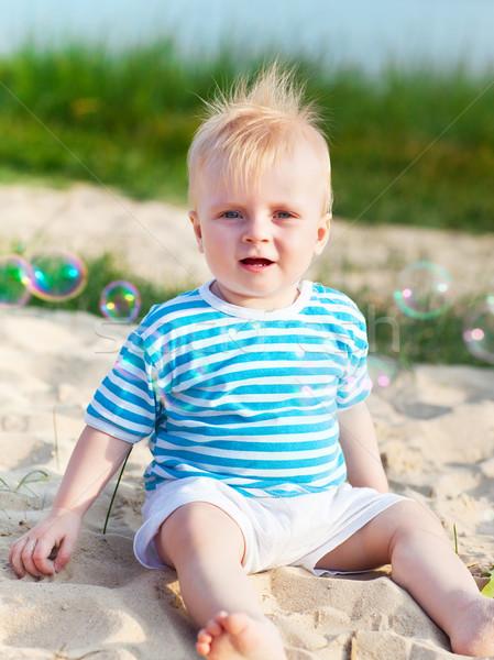 Bébé plage jouer bulles de savon eau fille Photo stock © dashapetrenko