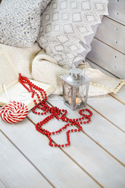 Christmas still life with lantern and red beads on wooden backgr Stock photo © dashapetrenko