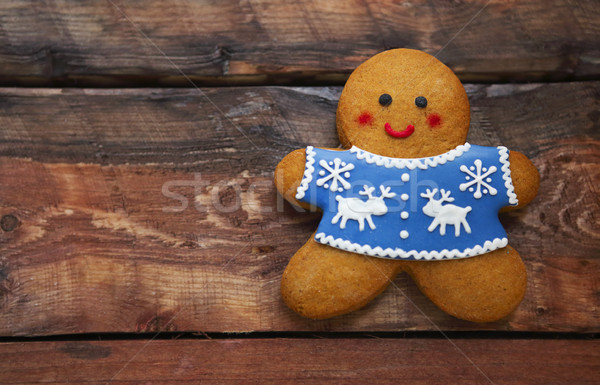 Smiling christmas gingerbread men on wooden background.  Stock photo © dashapetrenko