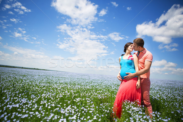 Portrait of a young beautiful pregnant couple in linen field Stock photo © dashapetrenko