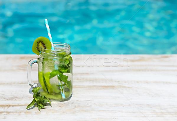 Homemade lemonade on wooden background Stock photo © dashapetrenko