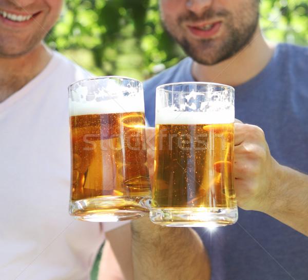 Két férfi szemüveg világos sör kert férfi fa Stock fotó © dashapetrenko