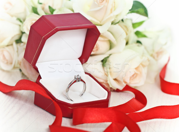 Marriage proposal. An engagement diamond ring Stock photo © dashapetrenko