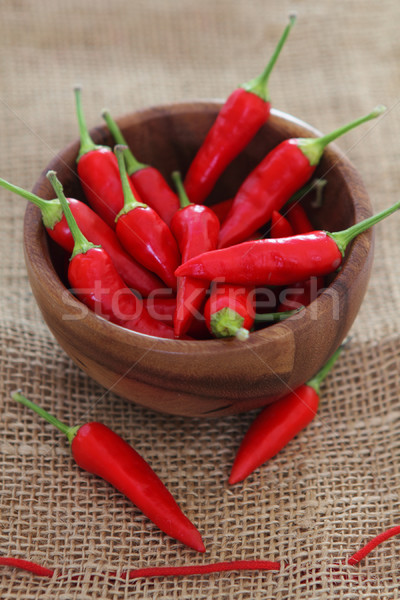 Red hot pepper in wooden bowl  Stock photo © dashapetrenko