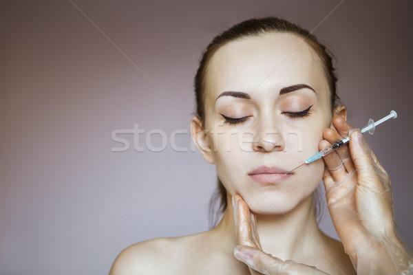 Fiatal csinos nő kozmetikai injekció arc ahogy Stock fotó © dashapetrenko