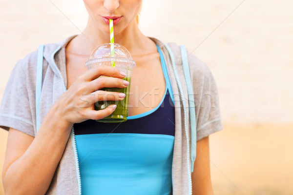 Woman drinking vegetable smoothie after fitness running workout  Stock photo © dashapetrenko
