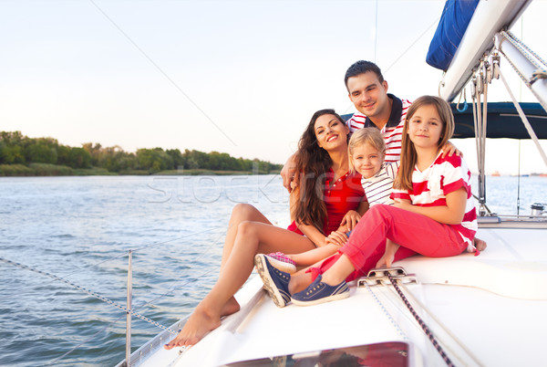Beautiful happy family with two daughters having great time at t Stock photo © dashapetrenko