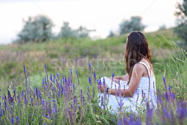 Woman sitting back in the grass. Stock photo © dashapetrenko