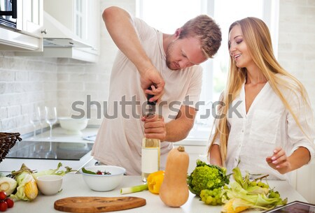 Young couple starting to drink a white wine at home Stock photo © dashapetrenko