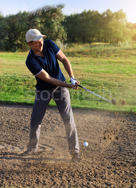 Golfer plays a sand trap shot  Stock photo © dashapetrenko