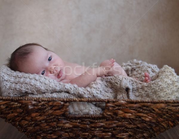 Baby boy in the basket on the wooden floor Stock photo © dashapetrenko