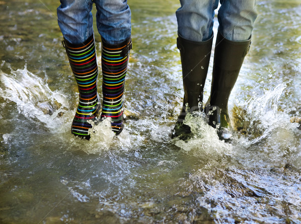Happy couple wearing colorful rain boots Stock photo © dashapetrenko