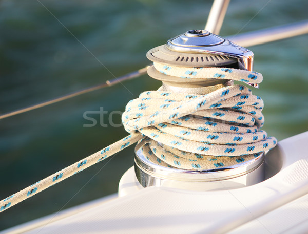 Sailboat detailed parts. Close up on winch and rope of yacht ove Stock photo © dashapetrenko