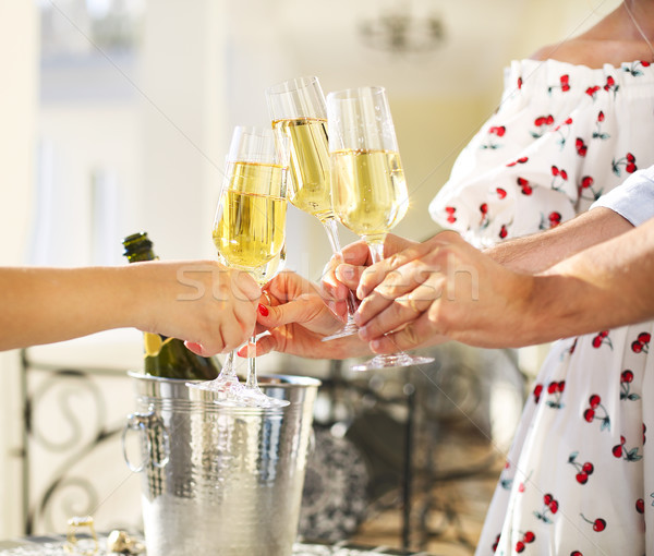 Friends making toast. Party with sparkling champagne glasses  Stock photo © dashapetrenko