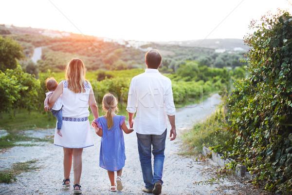 Family outdoors back view Stock photo © dashapetrenko