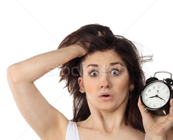 Surprised woman holding clock Stock photo © dashapetrenko