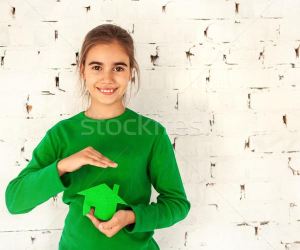 Kicsi mosolyog barna hajú lány tart üvegház Stock fotó © dashapetrenko