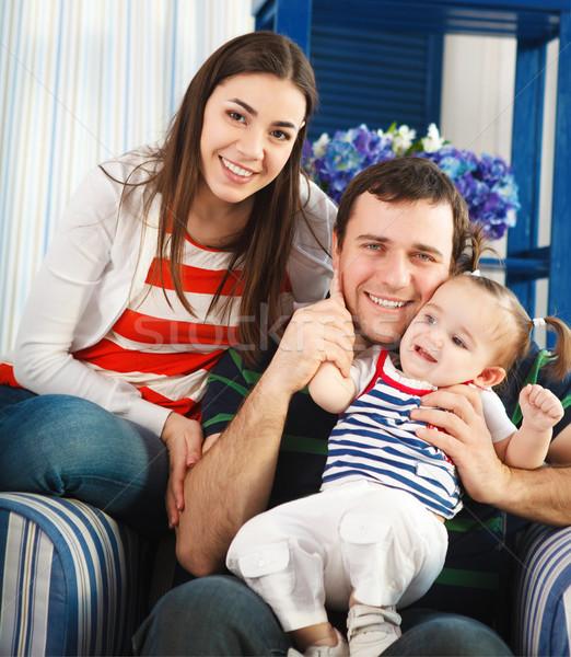 Boldog mosolyog család egyéves baba kislány Stock fotó © dashapetrenko