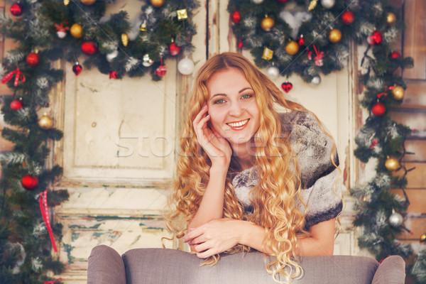 Beautiful happy woman in furcoat by the Christmas decorations Stock photo © dashapetrenko
