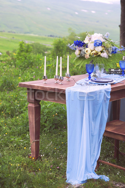 Bouquet of pink, violet and yellow flowers on a table set for di Stock photo © dashapetrenko