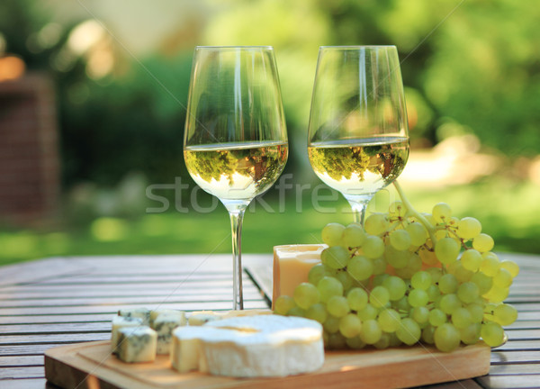 Various sorts of cheese and white wine Stock photo © dashapetrenko