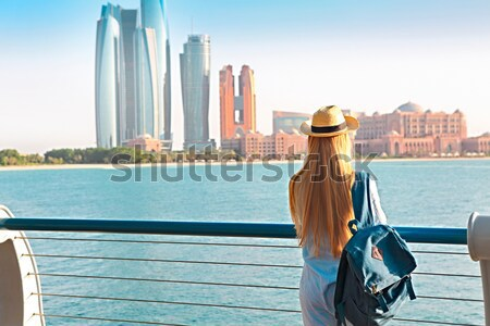Woman with backpack weaing the hat. On the background is panoram Stock photo © dashapetrenko