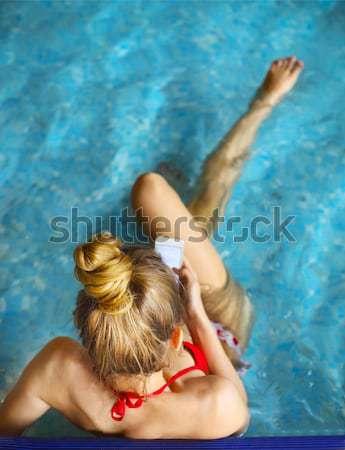 Gorgeous blonde woman in a pink bikini in the water Stock photo © dashapetrenko