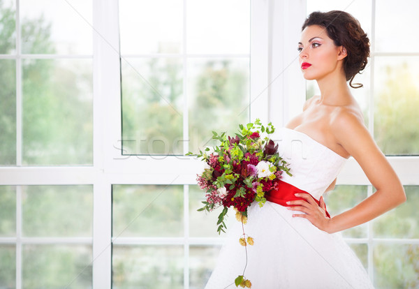 Bride holding unusual wedding bouquet  Stock photo © dashapetrenko