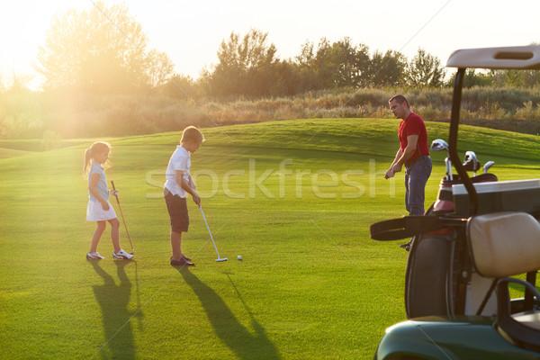 Lezser gyerekek golf mező tart golfütők Stock fotó © dashapetrenko