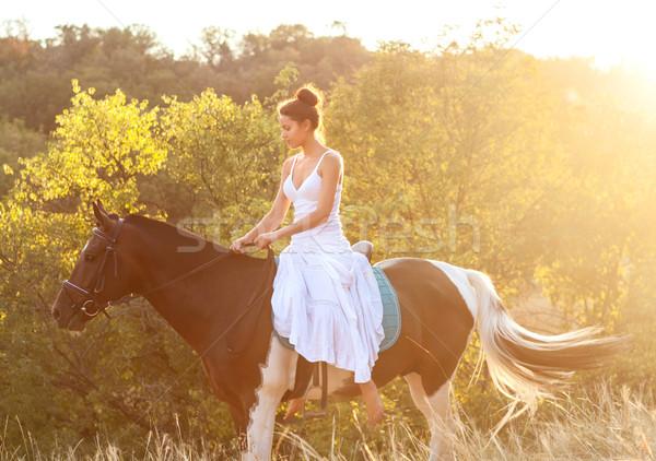 Beautiful woman riding on a horse Stock photo © dashapetrenko