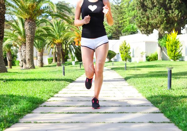 Runner feet running on road in the park. Woman fitness sunrise j Stock photo © dashapetrenko