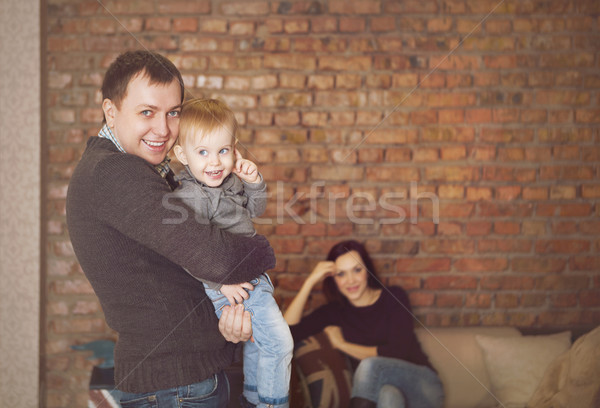 Happy young father, mother and cute baby girl  Stock photo © dashapetrenko