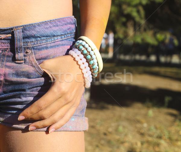 少女 着用 ブレスレット デニム ショートパンツ 祭り ストックフォト © dashapetrenko