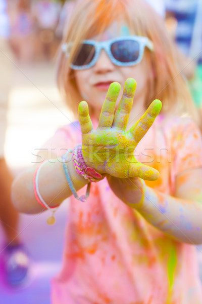 Happy cute litttle girl on holi color festival Stock photo © dashapetrenko