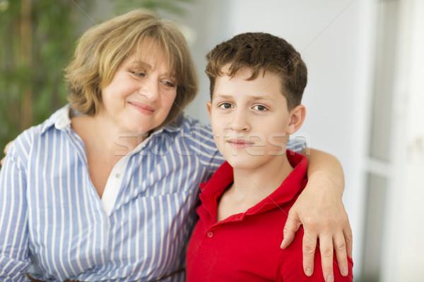 Mid-age woman with teen boy Stock photo © dashapetrenko