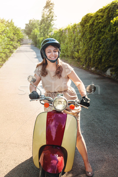 Young woman driving a scooter on a countryside road  Stock photo © dashapetrenko