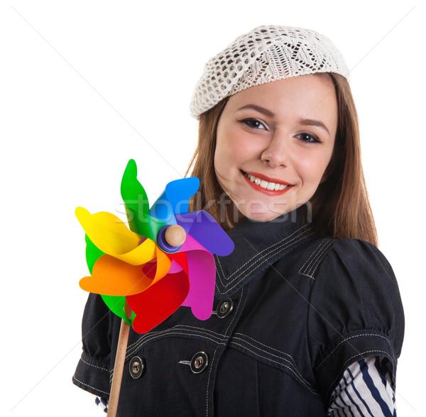 Young cute brunette girl with wind turbine toy Stock photo © dashapetrenko