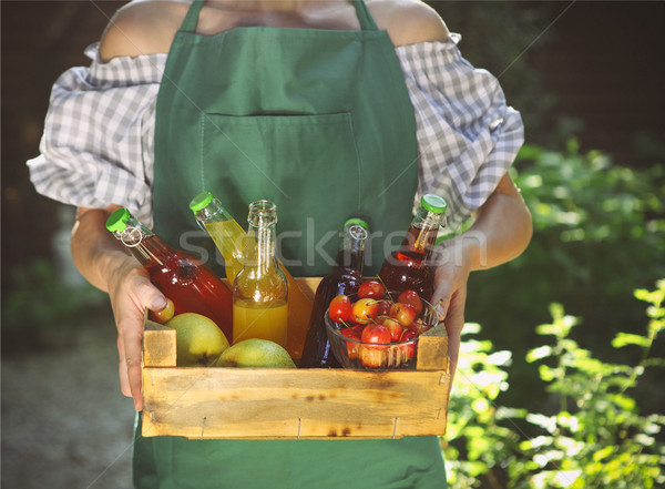 Woman holding wooden box with bottles of lemonade Stock photo © dashapetrenko