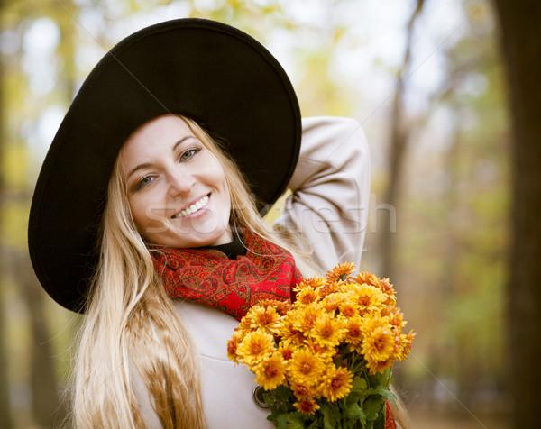 Fashionable blond woman at beautiful autumn alley Stock photo © dashapetrenko