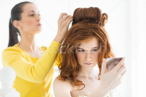 Hair stylist makes the bride  Stock photo © dashapetrenko