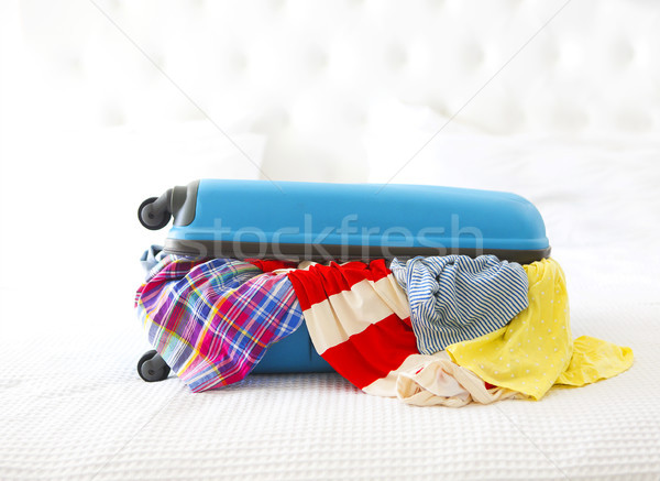 Clothes and accessories in turquoise suitcase Stock photo © dashapetrenko