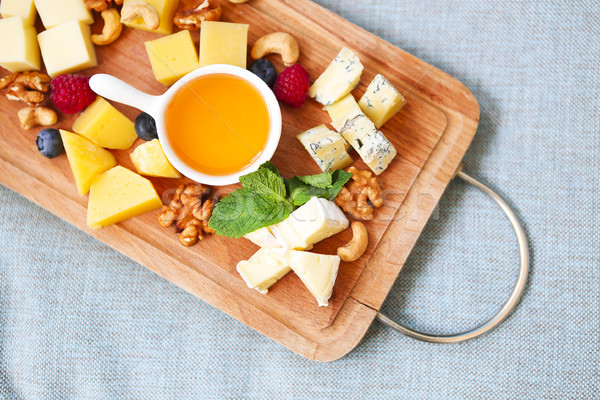 Cheese, honey, berries and nuts Stock photo © dashapetrenko