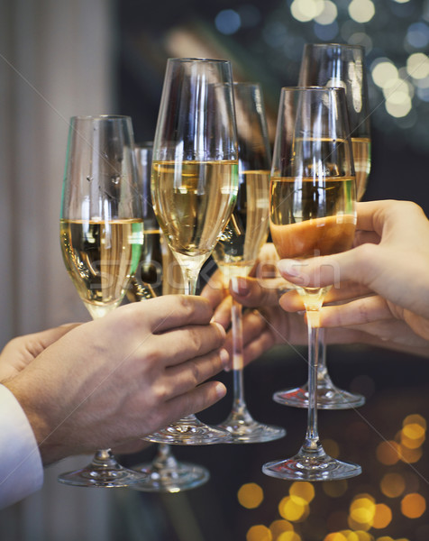 People holding glasses of champagne making a toast Stock photo © dashapetrenko