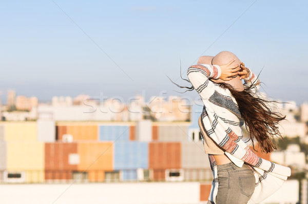 Young woman outdoors on city background in sunny day Stock photo © dashapetrenko