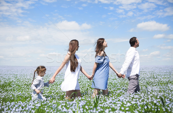 Portrait of a young pregnant family in linen field Stock photo © dashapetrenko